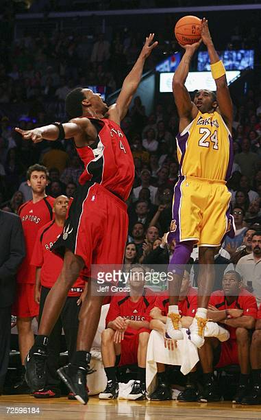 Kobe Bryant of the Los Angeles Lakers shoots over Chris Bosh of the Toronto Raptors during the second half of the game on November 17 2006 at Staples...