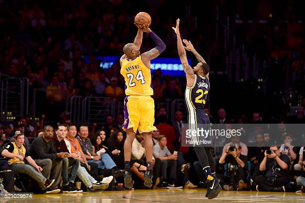 Kobe Bryant of the Los Angeles Lakers shoots over Chris Johnson of the Utah Jazz in the first half at Staples Center on April 13 2016 in Los Angeles...