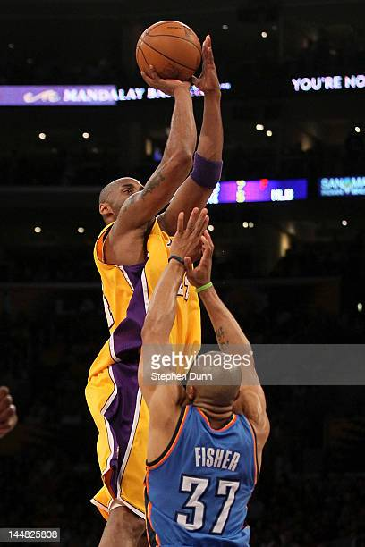 Kobe Bryant of the Los Angeles Lakers shoots over Derek Fisher of the Oklahoma City Thunder in the first quarter in Game Four of the Western...