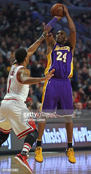 Kobe Bryant of the Los Angeles Lakers shoots over Derrick Rose of the Chicago Bulls at the United Center on February 21 2016 in Chicago Illinois NOTE...