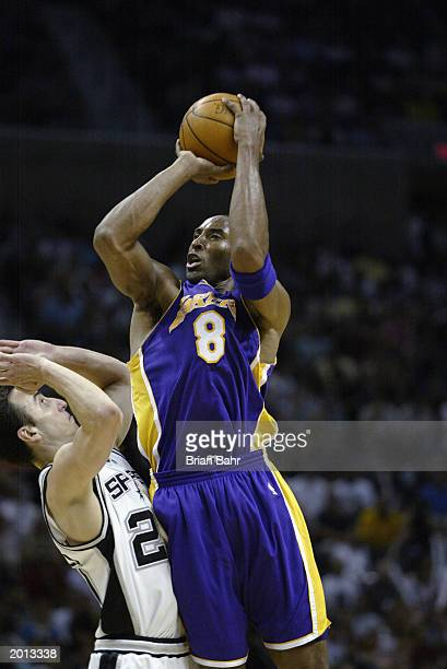 Kobe Bryant of the Los Angeles Lakers shoots over Emanuel Ginobili of the San Antonio Spurs in Game five of the Western Conference Semifinals during...