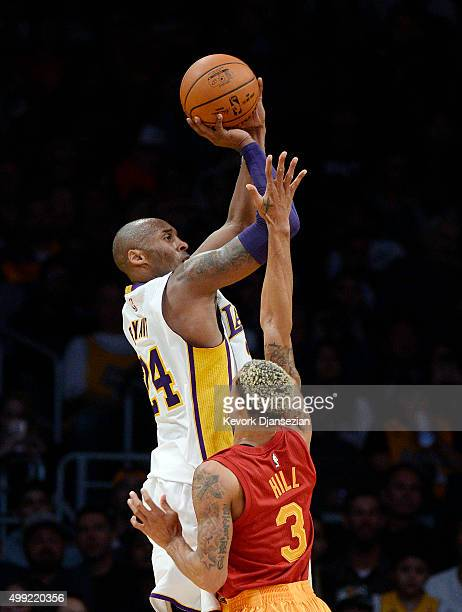 Kobe Bryant of the Los Angeles Lakers shoots over George Hill of the Indiana Pacers asks during the first half of the basketball at Staples Center...