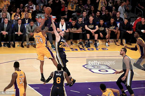 Kobe Bryant of the Los Angeles Lakers shoots over Gordon Hayward of the Utah Jazz in the second half at Staples Center on April 13, 2016 in Los...