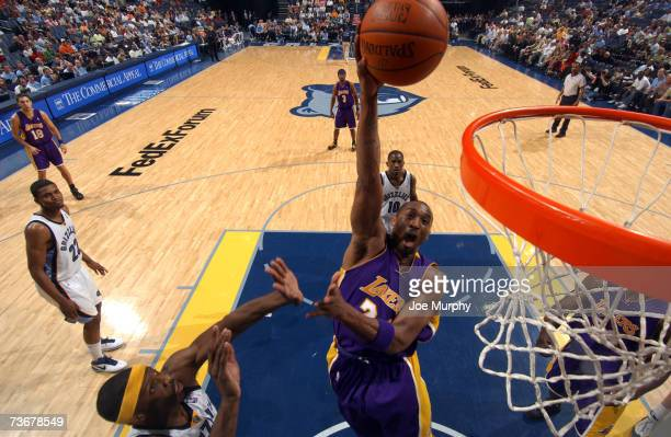 Kobe Bryant of the Los Angeles Lakers shoots over Hakim Warrick of the Memphis Grizzlies on March 22, 2007 at FedExForum in Memphis, Tennessee. NOTE...