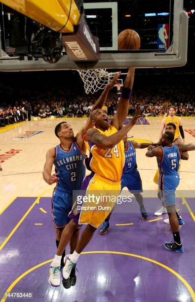 Kobe Bryant of the Los Angeles Lakers shoots over Thabo Sefolosha of the Oklahoma City Thunder in Game Three of the Western Conference Semifinals in...