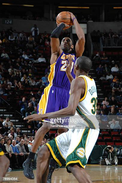 Kobe Bryant of the Los Angeles Lakers shoots over the defense of Kevin Durant of the Seattle SuperSonics on January 14 2008 at the Key Arena in...