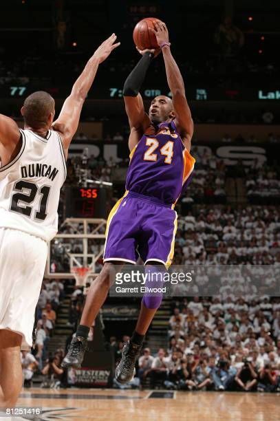 Kobe Bryant of the Los Angeles Lakers shoots over Tim Duncan of the San Antonio Spurs in Game Four of the Western Conference Finals during the 2008...