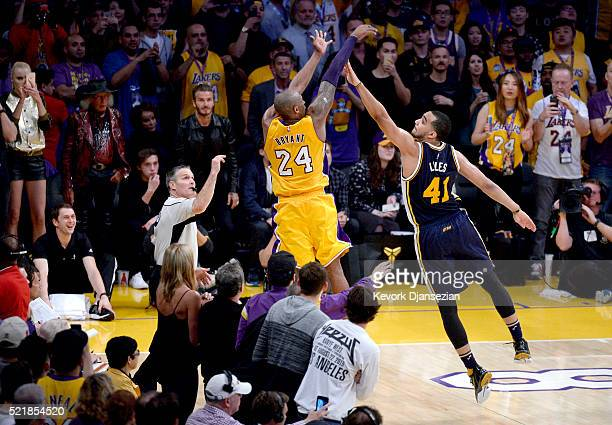 Kobe Bryant of the Los Angeles Lakers shoots over Trey Lyles of the Utah Jazz during the final game of his career on April 13, 2016 at Staples Center...
