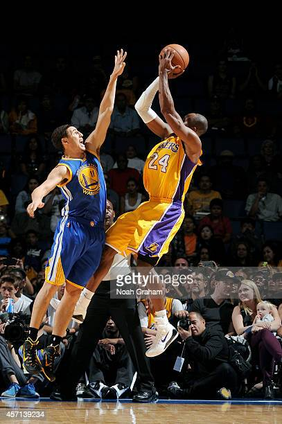 Kobe Bryant of the Los Angeles Lakers shoots the ball against Klay Thompson of the Golden State Warriors on October 12 2014 at Citizens Business Bank...