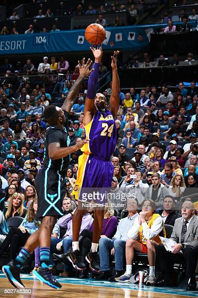Kobe Bryant of the Los Angeles Lakers shoots the ball during the game against the Charlotte Hornets on December 28 2015 at Time Warner Cable Arena in...