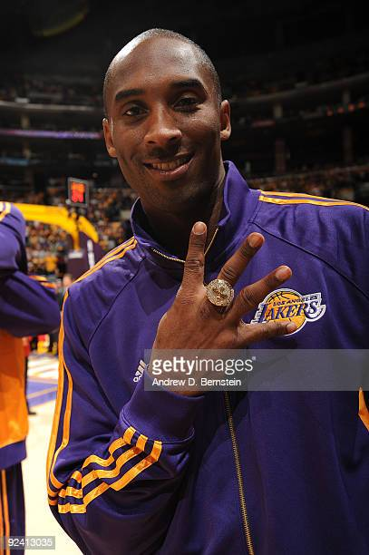 Kobe Bryant of the Los Angeles Lakers shows off his 2009 NBA Championship ring before the season opener against the Los Angeles Clippers at Staples...