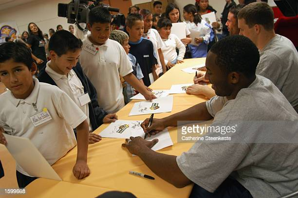 Kobe Bryant of the Los Angeles Lakers signs autographs after the NBA's official Read to Achieve Week at Miles Av Elementary School on October 21 2002...