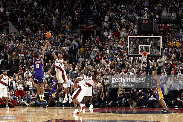 Kobe Bryant of the Los Angeles Lakers sinks a three point shot in the last seconds of a double overtime game against the Portland Trail Blazers on...