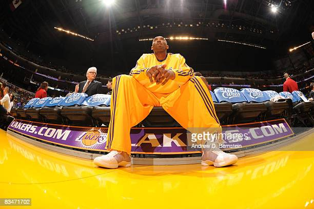 Kobe Bryant of the Los Angeles Lakers sits on the bench before the season opener against the Portland Trail Blazers at Staples Center on October 28...