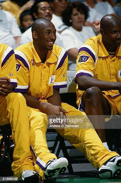 Kobe Bryant of the Los Angeles Lakers sits on the bench during an NBA preseason game against the Denver Nuggets at the Great Western Forum on...
