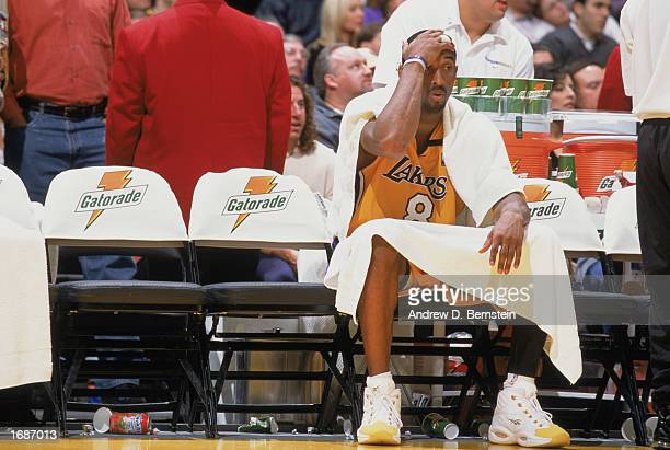 Kobe Bryant of the Los Angeles Lakers sits on the bench during the game against the Utah Jazz at Staples Center on December 8, 2002 in Los Angeles,...