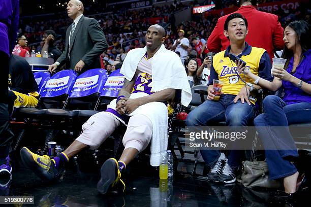 Kobe Bryant of the Los Angeles Lakers sits on the bench during the second half of an NBA game against the Los Angeles Clippers on April 5 2016 at...