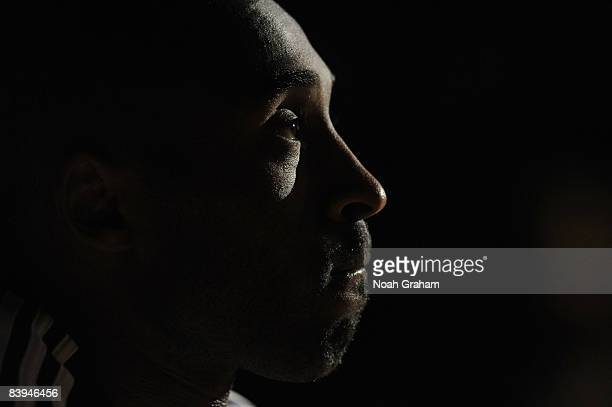 Kobe Bryant of the Los Angeles Lakers sits on the bench during the starting lineup announcements prior to the game against the Milwaukee Bucks at...