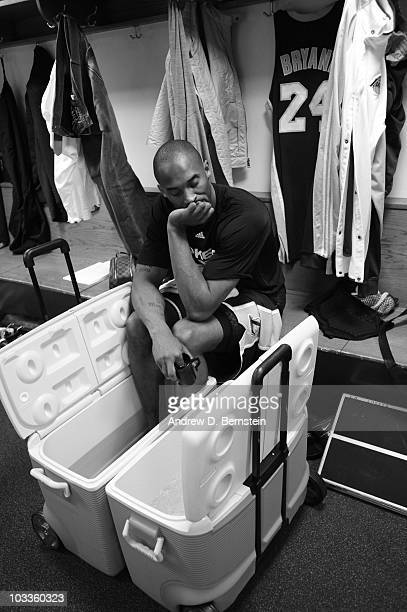 Kobe Bryant of the Los Angeles Lakers sits with his feet in an ice bucket in the locker room prior to the game against the New York Knicks on January...