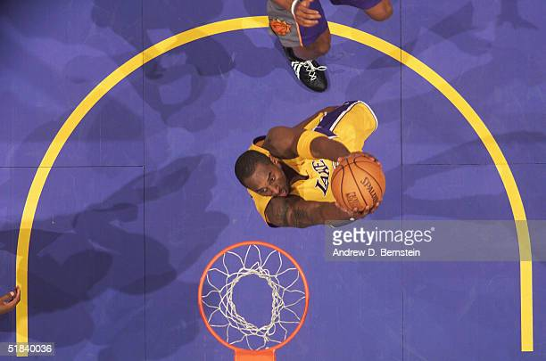 Kobe Bryant of the Los Angeles Lakers slam dunks against the Phoenix Suns at the Staples Center on December 8, 2004 in Los Angeles, California. NOTE...