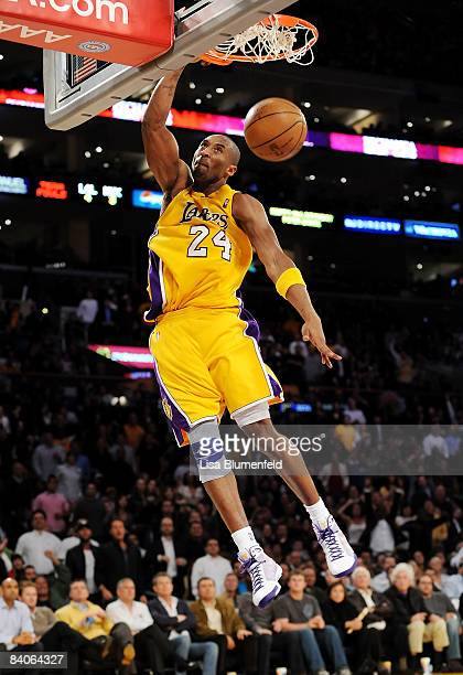 Kobe Bryant of the Los Angeles Lakers slam dunks during the game against the New York Knicks at Staples Center on December 16 2008 in Los Angeles...
