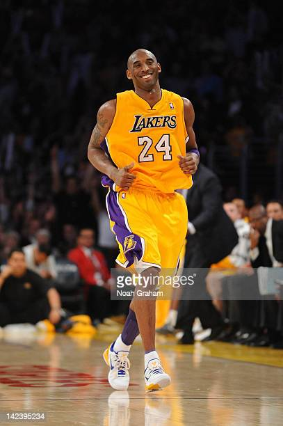 Kobe Bryant of the Los Angeles Lakers smiles after making a shot against the New Jersey Nets at Staples Center on April 3 2012 in Los Angeles...