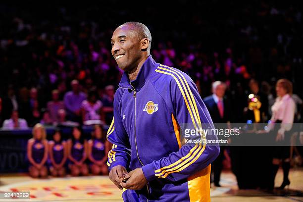 Kobe Bryant of the Los Angeles Lakers smiles after receiving his championship ring before the season opening game against the Los Angeles Clippers at...