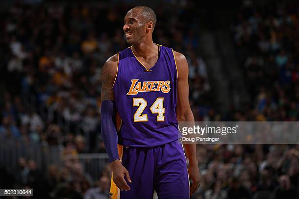 Kobe Bryant of the Los Angeles Lakers smiles as he takes the court against the Denver Nuggets at Pepsi Center on December 22 2015 in Denver Colorado...