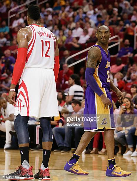 Kobe Bryant of the Los Angeles Lakers smiles at Dwight Howard of the Houston Rockets at Toyota Center on April 10 2016 in Houston Texas