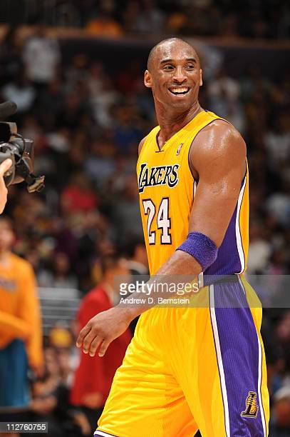 Kobe Bryant of the Los Angeles Lakers smiles during a game against the New Orleans Hornets in Game Two of the Western Conference Quarterfinals in the...