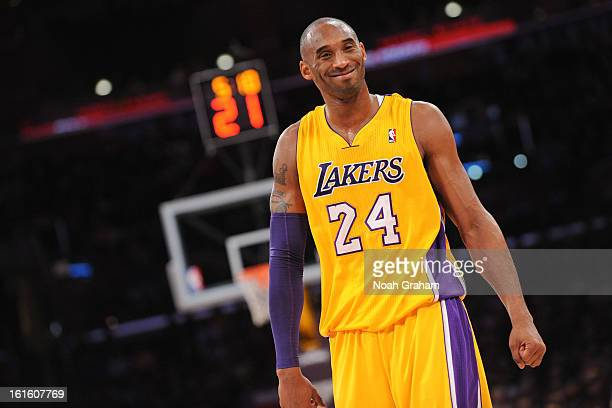 Kobe Bryant of the Los Angeles Lakers smiles during a game against the Phoenix Suns at Staples Center on February 12 2013 in Los Angeles California...