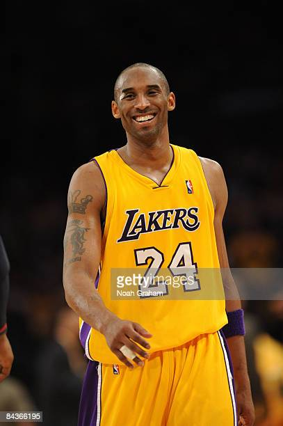 Kobe Bryant of the Los Angeles Lakers smiles during a game against the Cleveland Cavaliers at Staples Center on January 19 2009 in Los Angeles...
