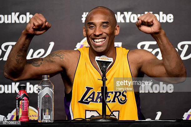 Kobe Bryant of the Los Angeles Lakers smiles during the post game news conference after scoring 60 points in the final game of his NBA career at...