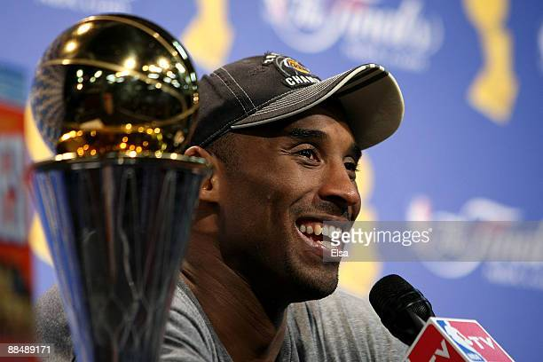 Kobe Bryant of the Los Angeles Lakers smiles during the post game news conference after the Lakers defeated the Orlando Magic 9986 to win the NBA...