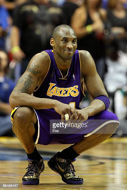 Kobe Bryant of the Los Angeles Lakers smiles in the final moments of the Lakers' win over the Orlando Magic in Game Five of the 2009 NBA Finals on...