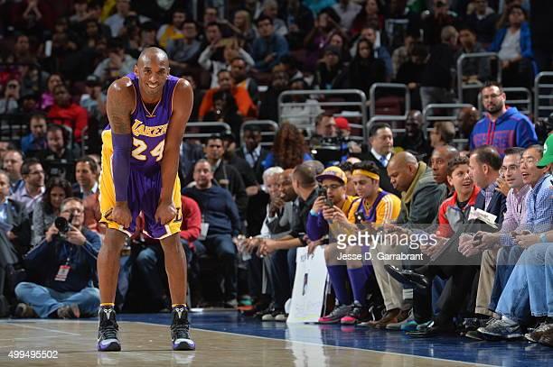 Kobe Bryant of the Los Angeles Lakers smiles of the crowd against the Philadelphia 76ers at Wells Fargo Center on December 1 2015 in Philadelphia...