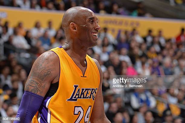 Kobe Bryant of the Los Angeles Lakers smiles on the court against the Minnesota Timberwolves on February 2 2016 at STAPLES Center in Los Angeles...