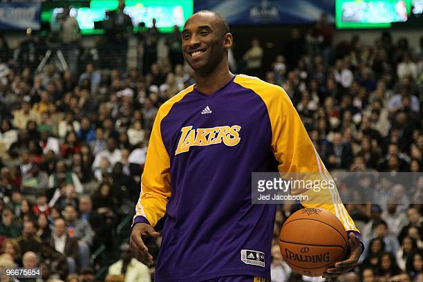 Kobe Bryant of the Los Angeles Lakers smiles while on court to assist teammate Shannon Brown during the Sprite Slam Dunk Contest on AllStar Saturday...
