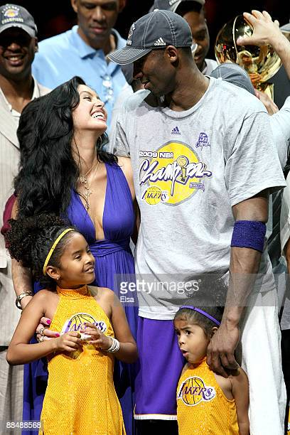 Kobe Bryant of the Los Angeles Lakers smiles with his wife Vanessa and his daughters Natalia and Gianna after the Lakers defeated the Orlando Magic...