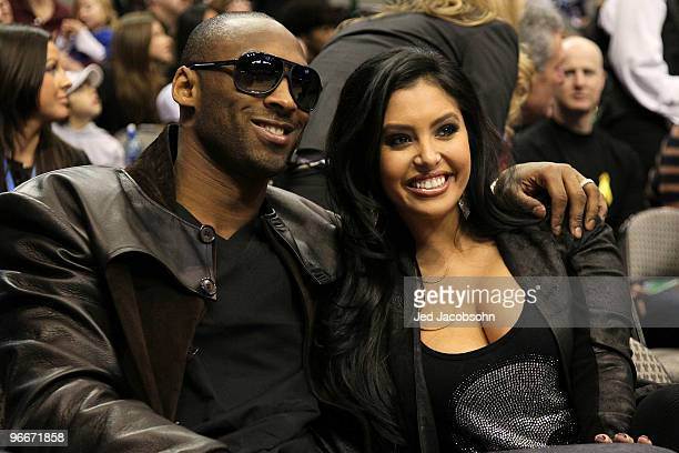 Kobe Bryant of the Los Angeles Lakers smiles with his wife Vanessa Lynne during the Taco Bell Skills Challenge on AllStar Saturday Night part of 2010...