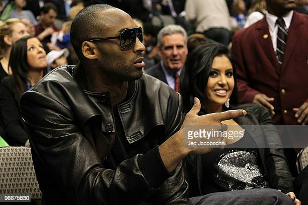Kobe Bryant of the Los Angeles Lakers smiles with his wife Vanessa Lynne during the Taco Bell Skills Challenge on All-Star Saturday Night, part of...