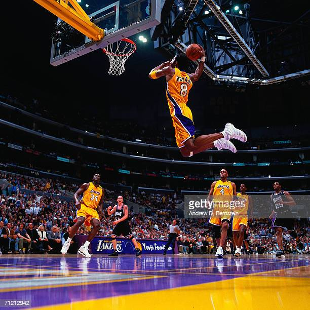 Kobe Bryant of the Los Angeles Lakers soars for a dunk against the Sacramento Kings at during a game in 2001 at Staples Center in Los Angeles...