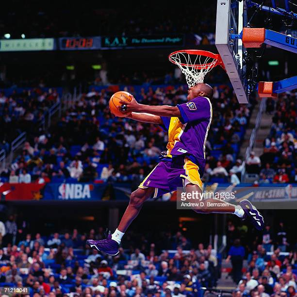 Kobe Bryant of the Los Angeles Lakers soars for a dunk during the 1997 NBA All Star Slam Dunk Contest February 8, 1997 at the Gund Arena in...