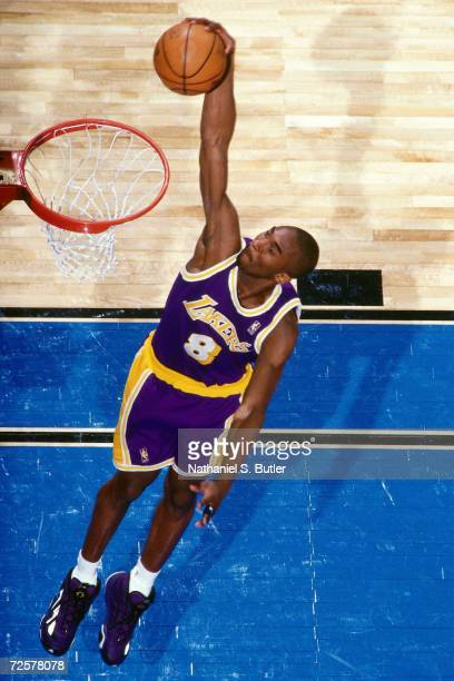 Kobe Bryant of the Los Angeles Lakers soars for a dunk during the 1997 Nestle Crunch Slam Dunk Contest on February 8, 1997 at the Gund Arena in...