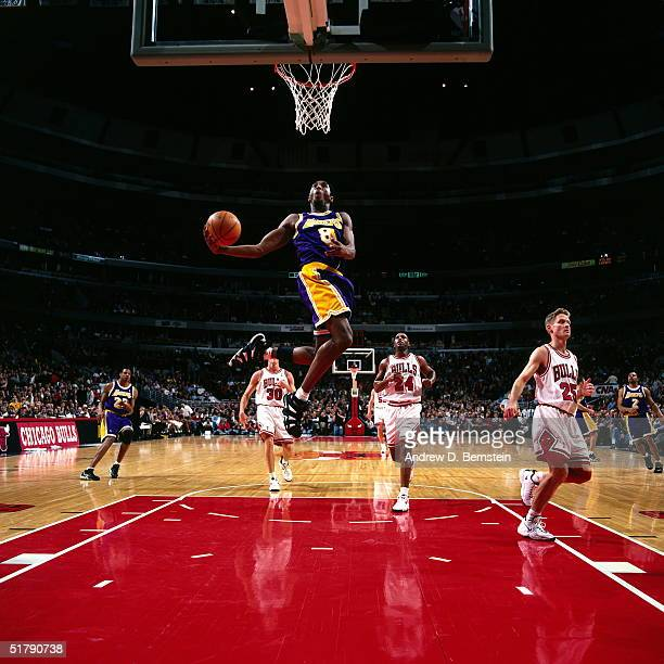 Kobe Bryant of the Los Angeles Lakers soars in for a reverse slam dunk against the Chicago Bulls during an NBA game at the United Center in 1998 in...
