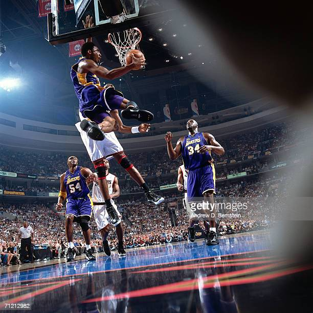 Kobe Bryant of the Los Angeles Lakers soars to the basket along the baseline for a reverse slam dunk against the Philadelphia 76ers during a 2001 NBA...