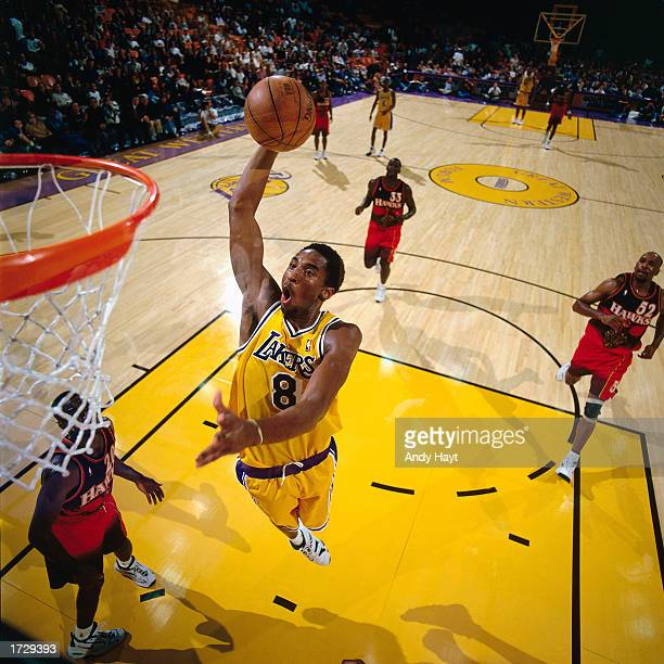 Kobe Bryant of the Los Angeles Lakers soars to the basket during a game against the Minnesota Timberwolves at the Staples Center on January 1 1998 in...