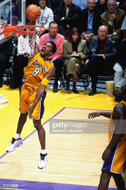 Kobe Bryant of the Los Angeles Lakers soars to the basket for a slam dunk during a 2000 NBA game at Staples Center in Los Angeles California NOTE TO...