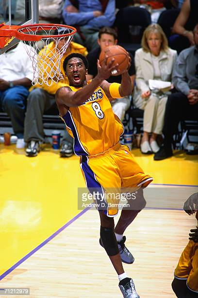 Kobe Bryant of the Los Angeles Lakers soars to the basket for a reverse slam dunk during a 2001 NBA Game at Staples Center in Los Angeles California...