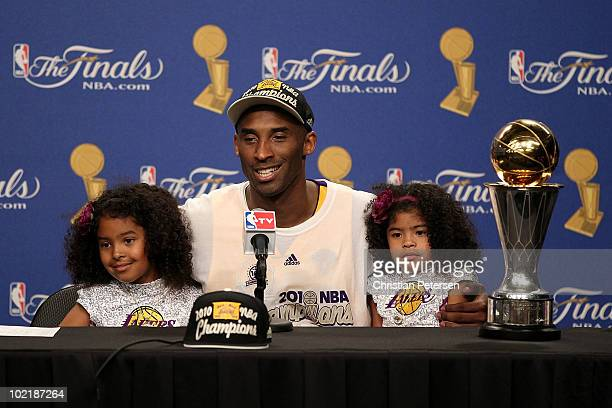Kobe Bryant of the Los Angeles Lakers speaks during the post game news conference with daughters Natalia and Gianna Bryant as he celebrates after the...